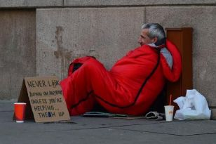 Cambridge raises £8,000 for night shelter after Ronald Coyne burns £20 in front of homeless man.