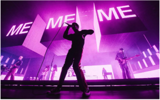 With a new cohort of dancers, treadmills and iPhone projections, The 1975 strive for zeitgeist as their UK tour reaches London.
